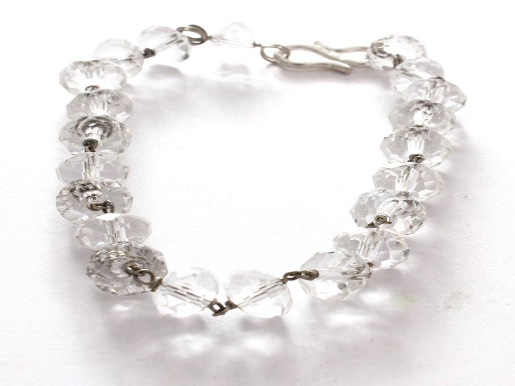 A lucky charm bracelet made of faceted crystal beads